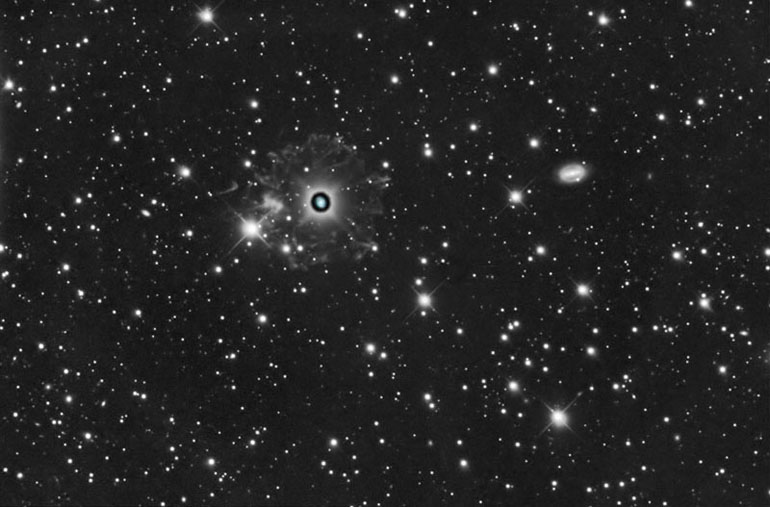 The Cat's Eye Nebula - NGC 6543, with surrounding nebulosity. The galaxy on the right is NGC 6552.