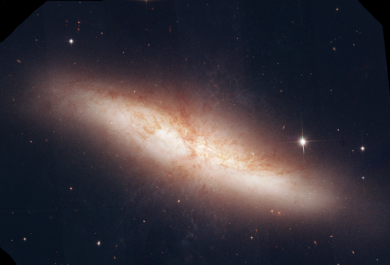 This is a mosaic of M82 taken by the Hubble Space Telescope. Using data from MAST, I used MaxIm DL and PhotoShop CS3 to process and assemble this image. Because the Hubble is in space, there are no atmospheric limitations which results in not only a striking image of the galaxy, but of the tiny galaxies that are peripheral to intended object. M82 is a cigar shaped irregular galaxy in the constellation Ursa Major