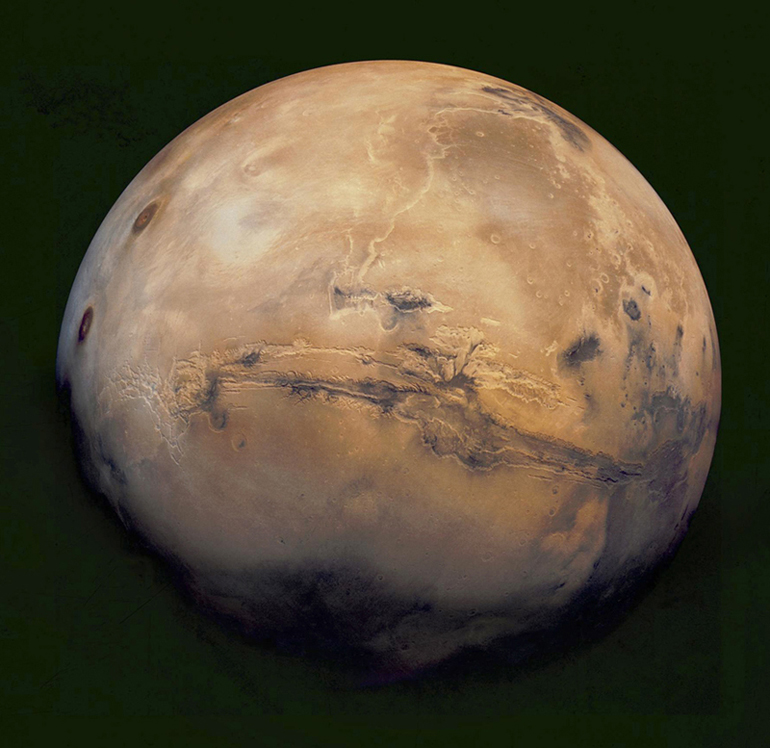 Global Mars from the Mariner orbiter. The Valles Marineris is the large feature.